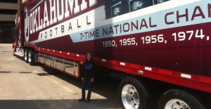 Leigha standing beside the OU Football supply truck.