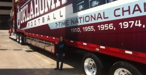 Leigha standing beside the OU Football supply truck.