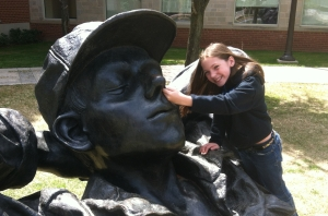 """After all, she is a kid.  This sculpture called """"The Dreamer"""" just needed his nose picked."""